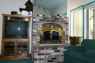 Living room TV and fireplace.