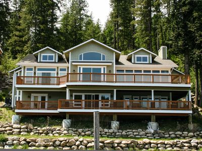 Photo for Grand waterfront home w/ decks offering lake views plus boat slip & nearby dock