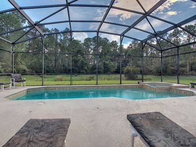 Photo for #Amazing Retreat with Pool Lanai Spa 12 Mins to Disney, Gated