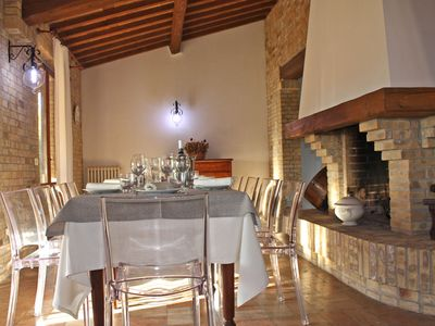 San Costanzo Villa Rental   Dining Area With Fireplace