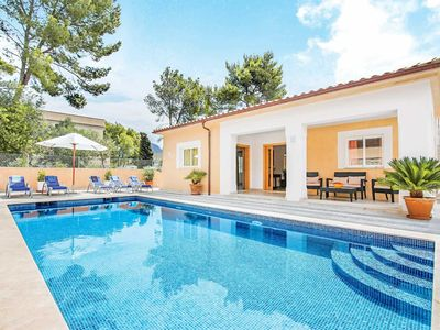 Photo for 4 bedroom Villa, sleeps 8 in Cala San Vicente with Pool, Air Con and WiFi