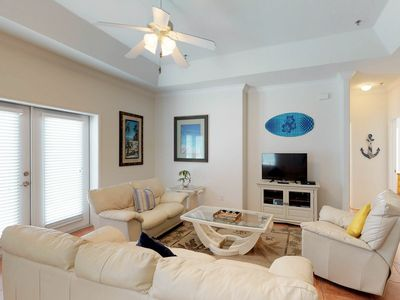 Photo for Dog-friendly condo w/ shared pool - one block to beach access!