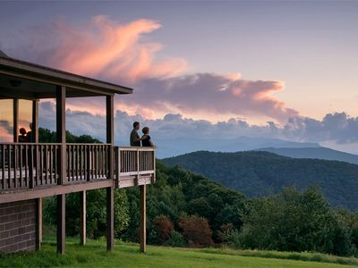 Guests enjoy a sunset view of the Smoky Mountains from the deck.