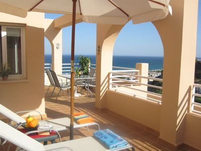 Photo for South facing apartment - spectacular sea & mountain views with pool