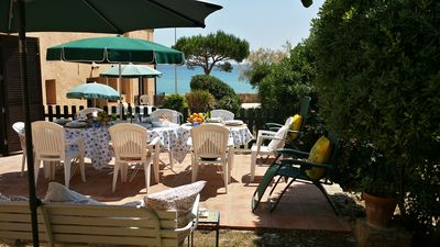 private terrace from the house at 25 meters from the beach outdoor table for 8 p