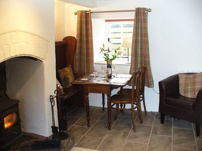 The dining area.Antique table,chairs and settle create a nostalgic atmosphere.