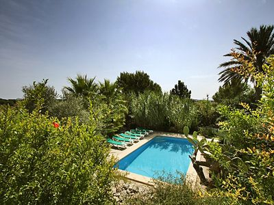 Photo for This 5-bedroom villa for up to 10 guests is located in San Llorenc Des Cardassar and has a private s