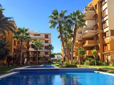 Photo for Luxurious apartment - Punta Prima - 2 bedrooms - Direct access to the pools