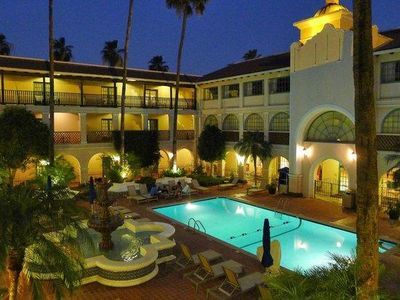 Photo for Close to Attractions! Cozy Unit for 4! Pool, Parking!
