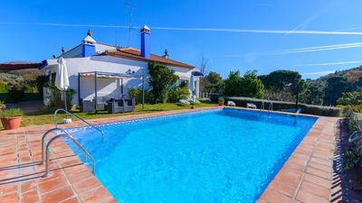 Photo for Nice 6-bedroom holiday villa with lovely garden in Seville province