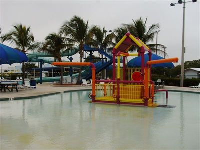 Exceptional pool with slides and in water play, very short walk away