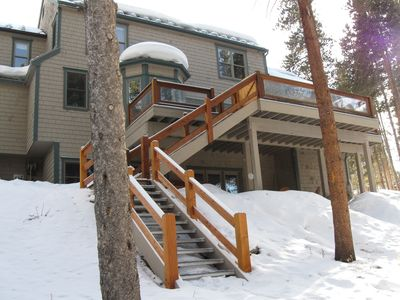 Photo for Walk to town or shuttle. in town riverfront home with hot tub