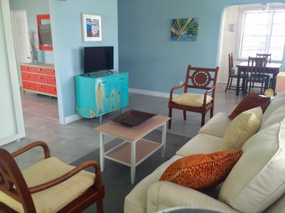 Photo for $99 April Special Mel Beach IN-TOWN BEACH LOCATION! Bright & Beachy!