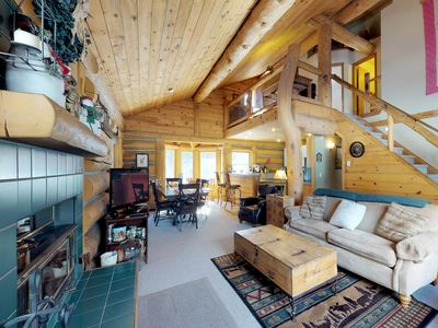 Photo for Dog-friendly log cabin w/ a private hot tub, firepit & room for the whole group!