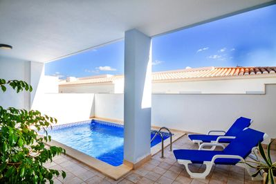 A beautifully private and sheltered poolside with large heated pool @ Casa Kissa