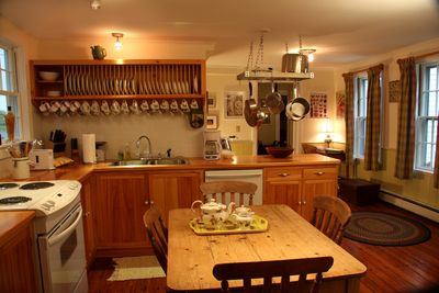 The lovely old eat-in kitchen; hand-crafted units; English Victorian pine table.