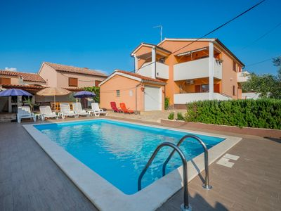 Photo for This 6-bedroom villa for up to 12 guests is located in Pula and has a private swimming pool, air-con