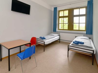 Photo for Room with shared shower / toilet and sink on floor - Hostel Guben