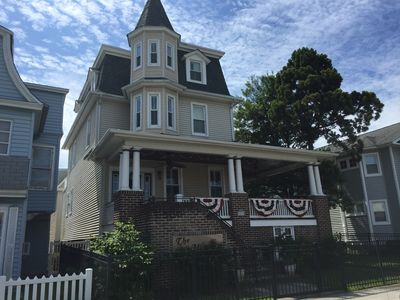 Front of this historic Victorian with fenced yard.