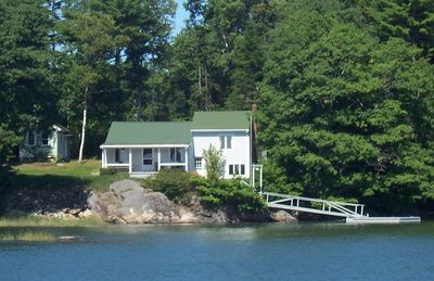 Photo for Oceanfront Cottage with Panoramic Views & Its Own Tidal Dock on Casco Bay