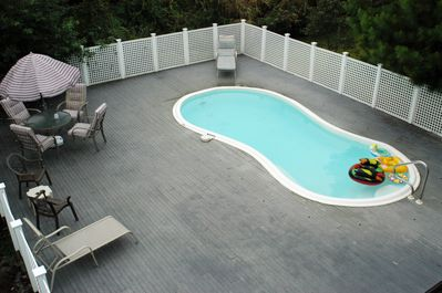 private pool, deck seating for 18, 2 covered decks over pool with more seating