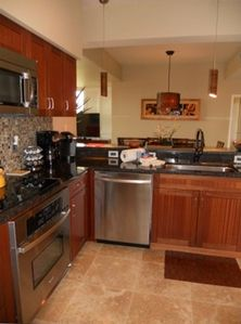 Newly remodeled kitchen which has stainless steel appliances and granite.