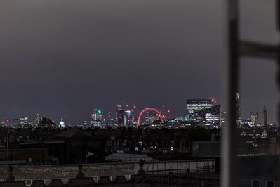 London lights up at night time. St Pauls is clearly visible