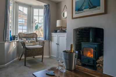 Woodburner & large sofa to cosy up on. There's TV & wifi or a good book to read
