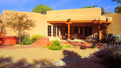 Photo for Bella Villa In Town luxury, Central A/C, hot tub walk to plaza enclosed yard