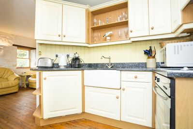 Kitchen with Coffee Machine, Kettle, Microwave, Fridge/Freezer, Oven and Cutlery