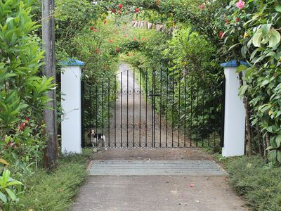 Private and Gated --- View of front gate.