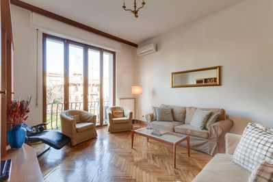 Sitting room with balcony and view of the river Mugnone