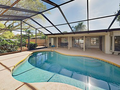 Photo for Sparkling Beach Getaway w/ Private Screened Pool & Central Locale