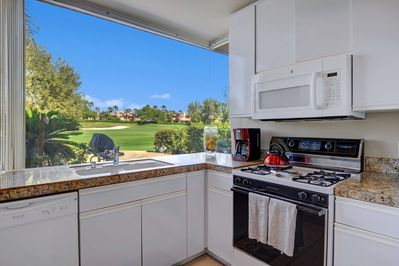 Granite Kitchen, Gas Stove and Oven with a Northern View of the 2nd hole.
