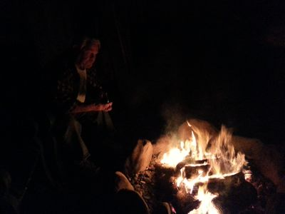 Relaxing by the fire with a glass of wine.  We supply good firewood.