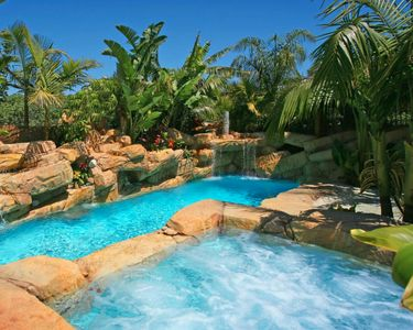 Photo for 1-acre Resort with beach style pool