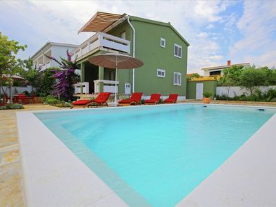 Photo for Charming two-storey villa with heatable pool nice terrace, BBQ, 50m from the sea
