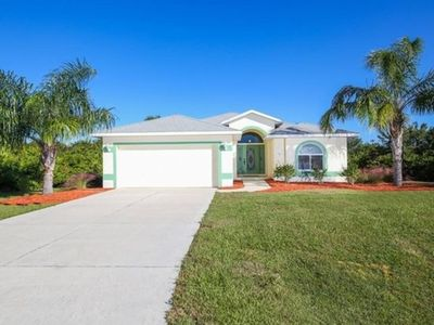 Photo for Ambiance, peace and privacy! A beautiful 3 bedroom, 2 bath tropical pool home.