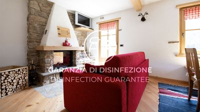 Photo for Brilliant apartment with fireplace, in the heart of the Alps