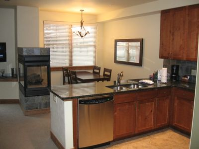 View of Kitchen & Dining Room w/ Gas Fireplace
