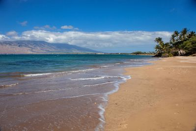 White sandy beach across the street from Kihei Bay Surf.