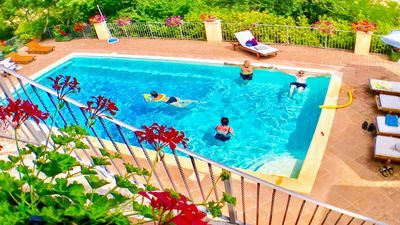 Photo for Spoleto Splash - slps 20, luxury village of 5 cottages, exc pool, private ground