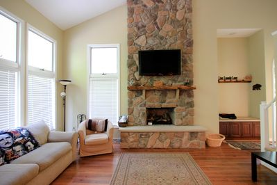 Main Living Room area with Large Flat Screen TV and Gas Fireplace