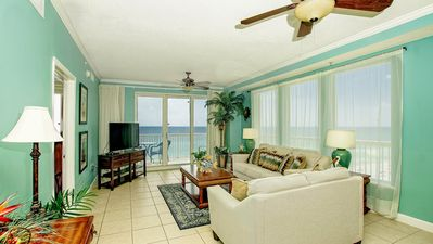 Photo for Beautiful beach front condo with wrap around balcony, summer dates open!