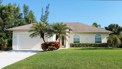 Photo for Waterfront dreamhome with pool in southern exposure, tropical flair, Golf Course