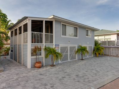 Photo for Oceanfront home w/ a screened-in porch, only steps from the beach!