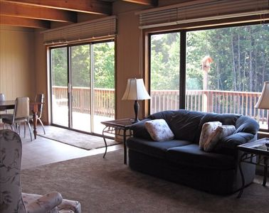 Large family and dining areas lead out onto the deck. Views everywhere!