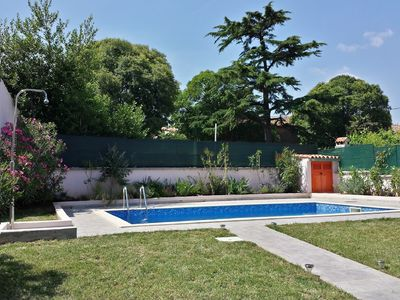 Photo for Lovely family house with swimmingpool, mediterranean garden, terrace and grill