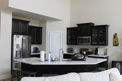 Gourmet kitchen - upgraded appliances, quartz countertops, well-stocked.