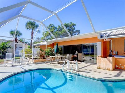 Your family will enjoy our screened lanai and heated pool - Poolside perfection -- plenty of lounge chairs, a dining area, and a screened lanai!